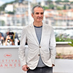 "French director Olivier Assayas poses on May 17, 2016 during a photocall for the film ""Personal Shopper"" at the 69th Cannes Film Festival in Cannes, southern France.  / AFP PHOTO / LOIC VENANCE"
