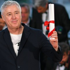 French director Robin Campillo poses on May 28, 2017 during a photocall after he won the Grand Prix for the film '120 Beats Per Minute (120 Battements Par Minute)' at the 70th edition of the Cannes Film Festival in Cannes, southern France.  / AFP PHOTO / LOIC VENANCE